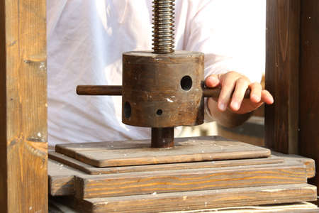 old lathe with the grip for the artisan processing of paper