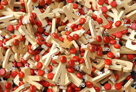 many letters in wood with Red wheels to compose words and name of children