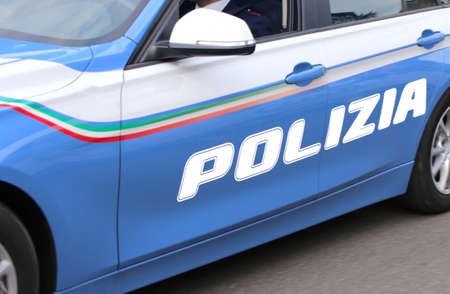 fast car of the Italian police with big POLICE written on city streets