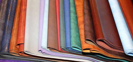 many colored leather pieces for sale in the workshop in Florence Italy