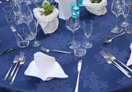 elegant table set before the official lunch with white dish and table napkin