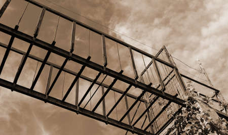 suspended bridge of rusted with sepia toned effect