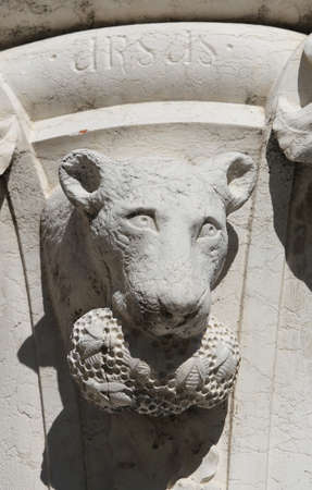 Venice, Italy - July 14, 2016: detail of a statue of a bear in a column in  Saint Mark Square near the Ducal Palace. The text URSUS means BEAR in Latin Language