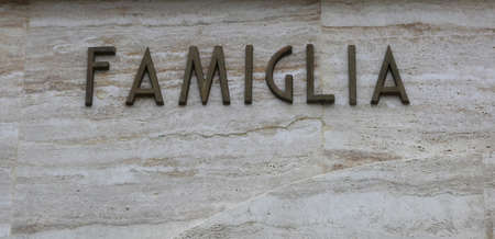 Foto per big text FAMIGLIA that means famiyl in Italy Language with copy space - Immagine Royalty Free