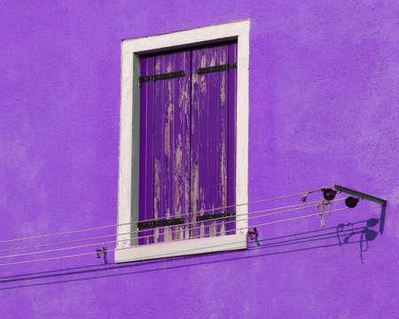 purple wall and balcony the island of Burano near Venice in Italy