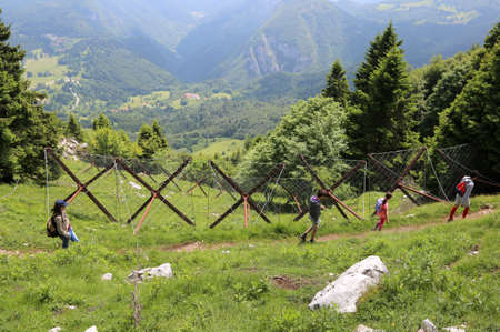 Foto per family of four people with children walks on the mountains - Immagine Royalty Free