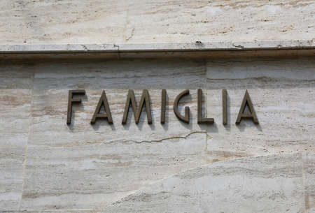 Foto per big text FAMGILIA which means Family in Italian language on marble background - Immagine Royalty Free