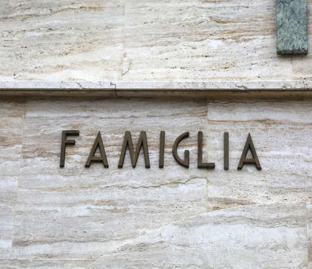 Foto per big text FAMIGLIA that means Family in Italian Language - Immagine Royalty Free