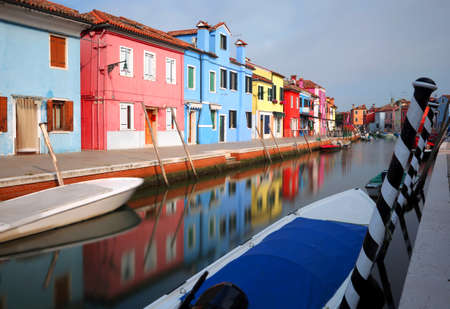 colored houses in the Burano Isle near Venice in Italy with navigable canal