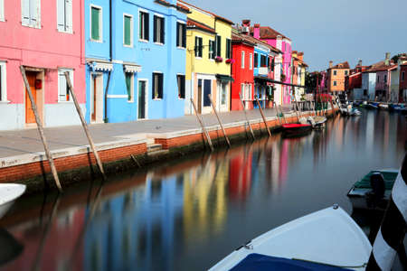 Reflection of colored houses on a canal on the island of Burano, near Venice