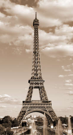 Foto de Eiffel Tower symbol of Paris in France in sepia toned effect with clouds - Imagen libre de derechos