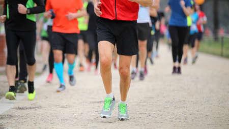 Foto de Legs of many runners at footrace  in the city - Imagen libre de derechos