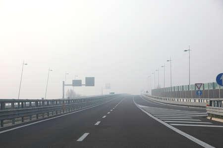 dense fog very dangerous for motorists on the highway junction in winter