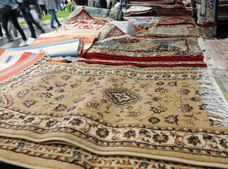 stand of carpets at local market on the street
