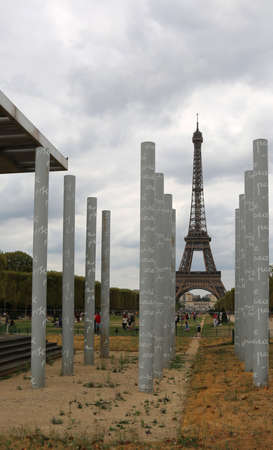 Paris, France - August 21, 18: columns of Memorial called Wall of Peace and the Eiffel Tower