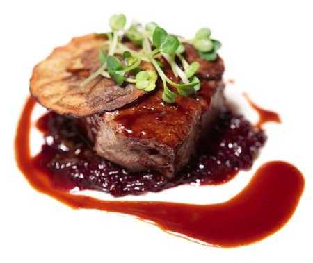 Tasty tenderloin steak with red sauce