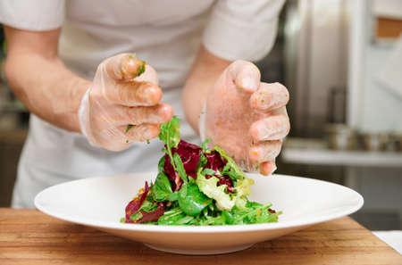 Photo pour Chef is making an appetizer at professional kitchen - image libre de droit