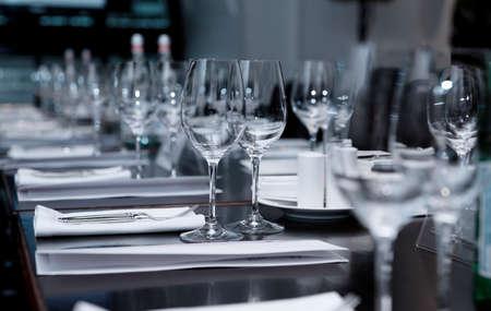 Table set for official dinner, focus on glasses