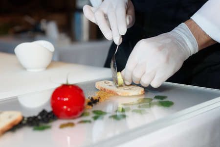 Photo for Chef is cooking an elegant gourmet dish - Royalty Free Image