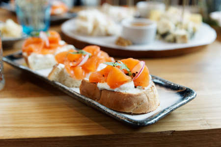 Foto de Bruschettas with smoked salmon and cream cheese, close-up - Imagen libre de derechos