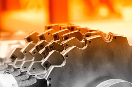 New modern industrial mill. Close up. Small depth of sharpness. Selective red toning