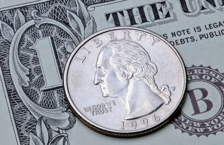 US coin quarter dollar on one dollar bill. Reverse of the coin 25 US cents on a banknote 1 US dollar