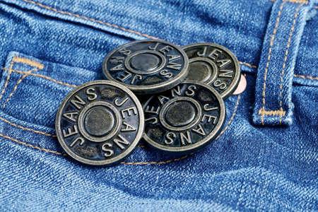 Photo pour Metal buttons with inscription Jeans on a denim. - image libre de droit