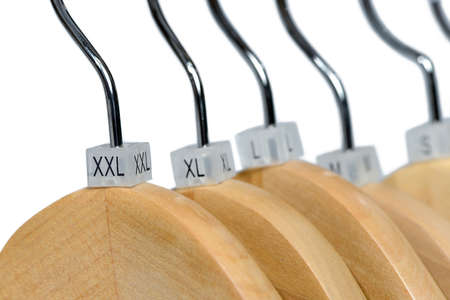 Plastic clothing size tags, plastic size labels on hangers for clothing store with indexes of the XXS, XS, S, M, L, XL, XXL sizes isolated on white