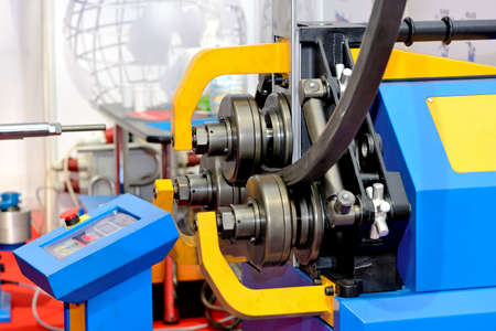 Photo pour Industrial machine for bending steel pipes and metal rods. Pipe bending machine - image libre de droit
