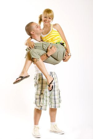 young man holding his girlfriend on his arms