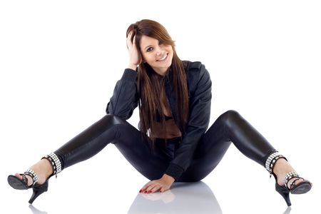 picture of a woman wearing leather outfit, seated over white