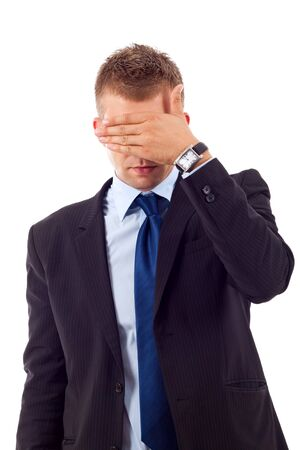 businessman making the see no evil gesture over white