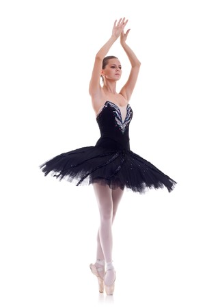 Professional ballet dancer isolated in studio , over white