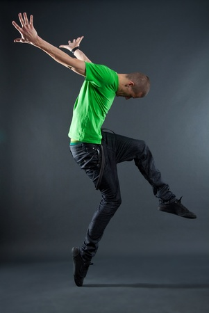 hip-hop style dancer posing on isolated grey background
