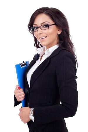 Photo pour Portrait of a young confident business woman holding a clipboard - image libre de droit