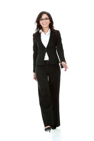 picture of a young business woman walking towards the camera