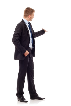 Full length of successful business man presenting something at his back over white background