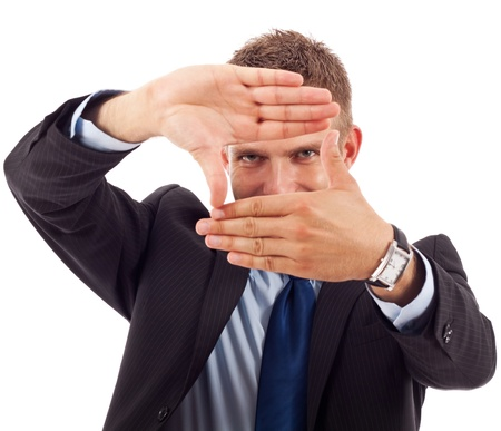 Young business man making a hand frame isolated on white