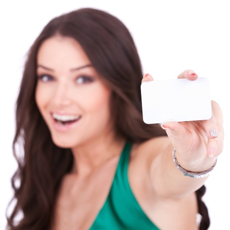 Close-up portrait of female holding credit card, shallow depth of field, focus on the credit card, over white background