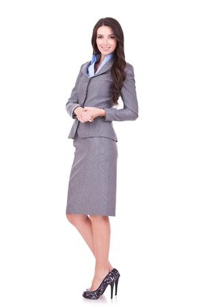 Foto de Full length portrait of a confident young business woman standing on white background  - Imagen libre de derechos