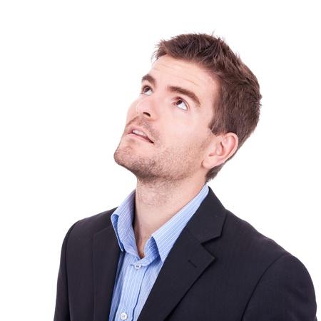 Photo pour Young business man looking up on white background - image libre de droit