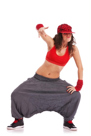 modern woman street dancer posing in a cool position showing rock sign