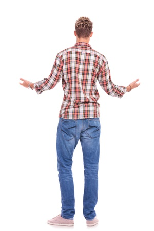 back view of a young casual man welcoming someone, isolated on white background