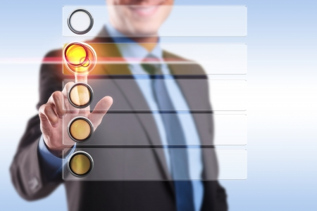 Photo pour smiling business man choosing and pushing a button from a blank list of options - image libre de droit