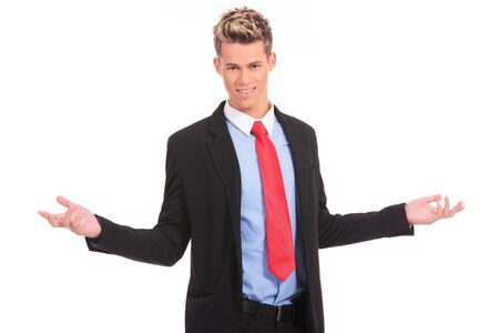 Approachable young business man with open arms isolated