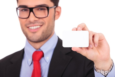 Portrait of young business man isolated on white background. Holding blank business card and smiling