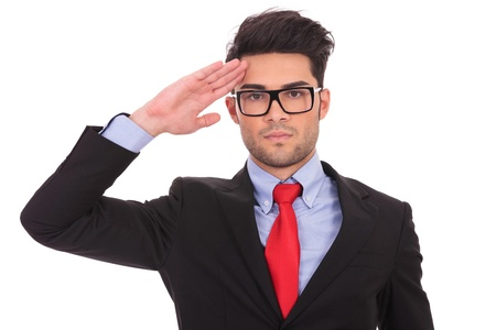Foto per portrait of ayoung business man saluting and looking at the camera on white - Immagine Royalty Free
