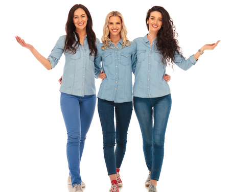Photo for 3 happy casual women walking and welcoming you to their team , on white studio background - Royalty Free Image