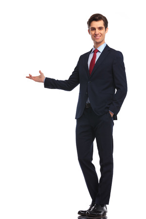 Foto per happy businessman presenting something on white background - Immagine Royalty Free
