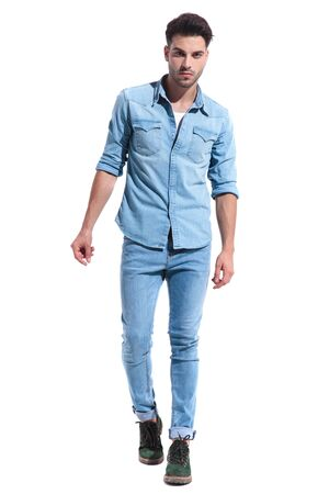 Photo pour casual young man walking isolated on white background wearing a full denim outfit; full body, full length - image libre de droit